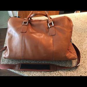 Gently used Wilson leather duffel bag